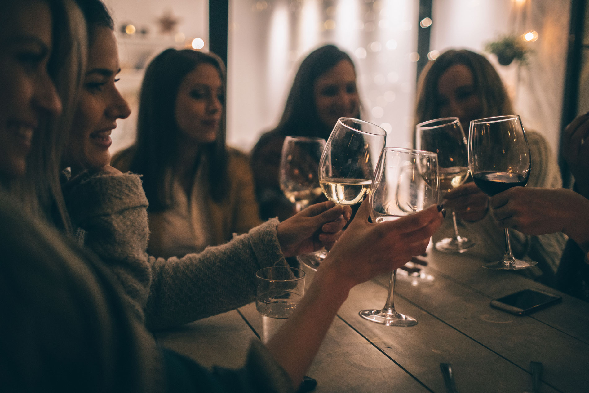 friends enjoying red and white wine at a party together